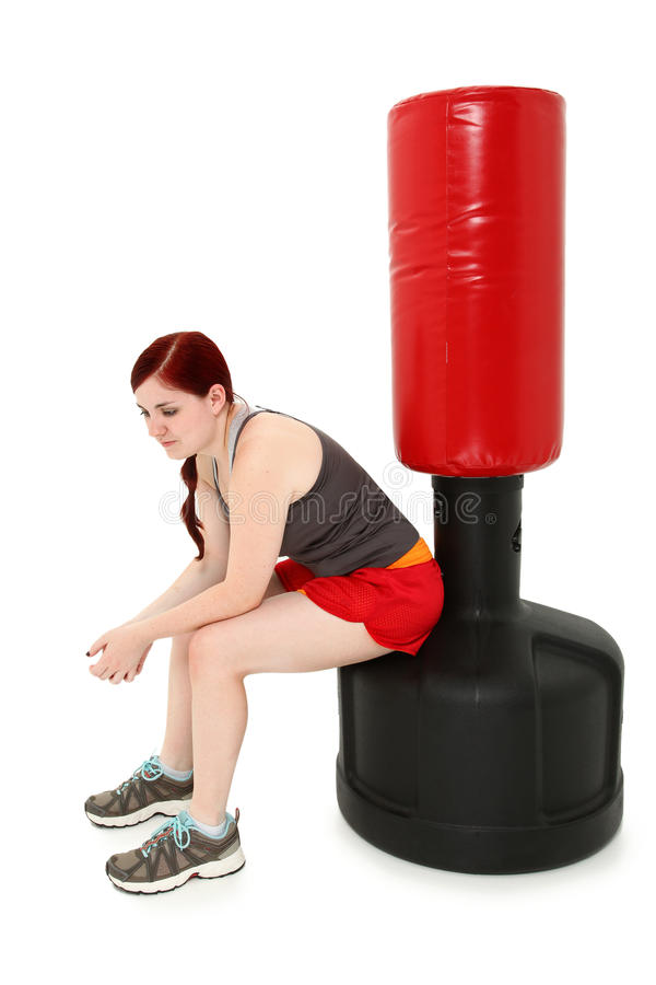 Resting After Workout with Heavy Bag stock photo