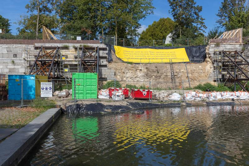 Restoration of the collapsed ancient defense wall in downtown Maastricht stock photos