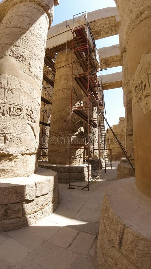 Restoration, columns in the Karnak temple complex, a famous architectural monument in Luxor, Egypt. Pillars of the Great Hypostyle. Hall from Amon Re Site stock photo