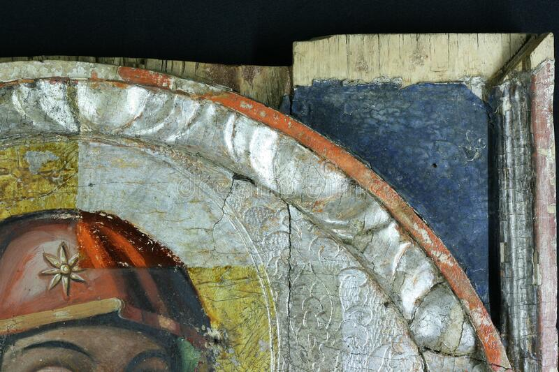 Restoration of painting. fragment with probing in the process of restoration. old painting. royalty free stock photo