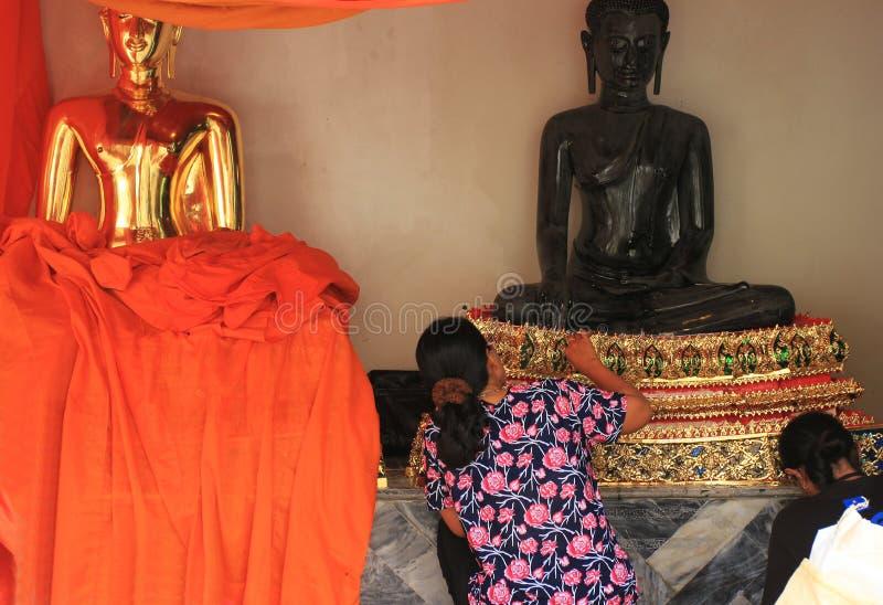 Restorators of buddhist temple in Bangkok, Thailand royalty free stock photo