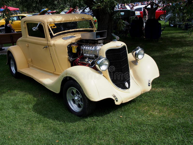 Restored Antique Cream Coloured Roadster. On display royalty free stock photography