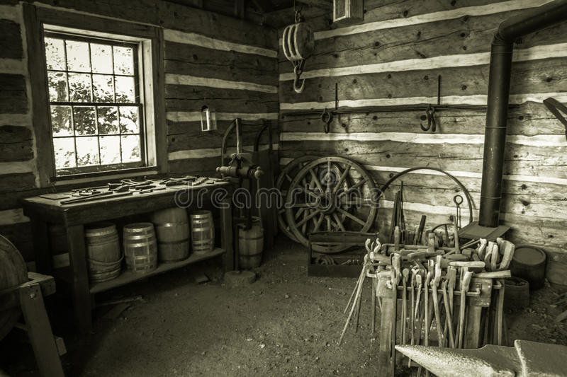 Restored Blacksmith Workshop. Copper Harbor, Michigan, USA - August 24, 2013. Interior of a blacksmith shop at Fort Wilkins State Historic Park in Copper Harbor royalty free stock image