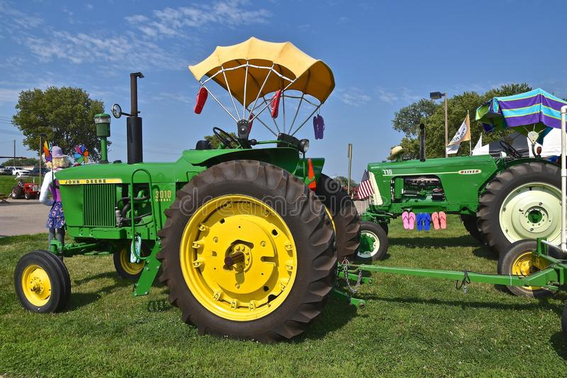 Restored John Deere 3010 and Oliver 770 tractorrs royalty free stock photos