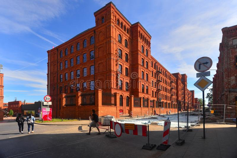 Restored old textile factory in Lodz, Poland. View of an beautifully renovated old textile factory transformed into elegant shopping and exhibition centre in royalty free stock image