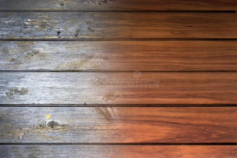 Time Old New Wood Background. A wood panel that goes from old and worn to new and varnished stock photography