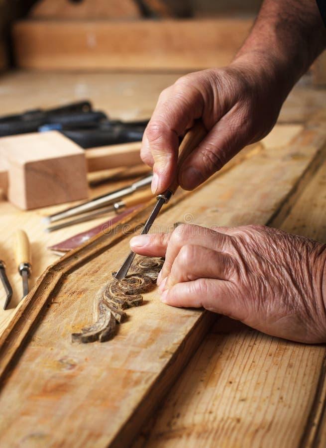 Restoring old furniture. Senior carpenter restoring old furniture stock photo
