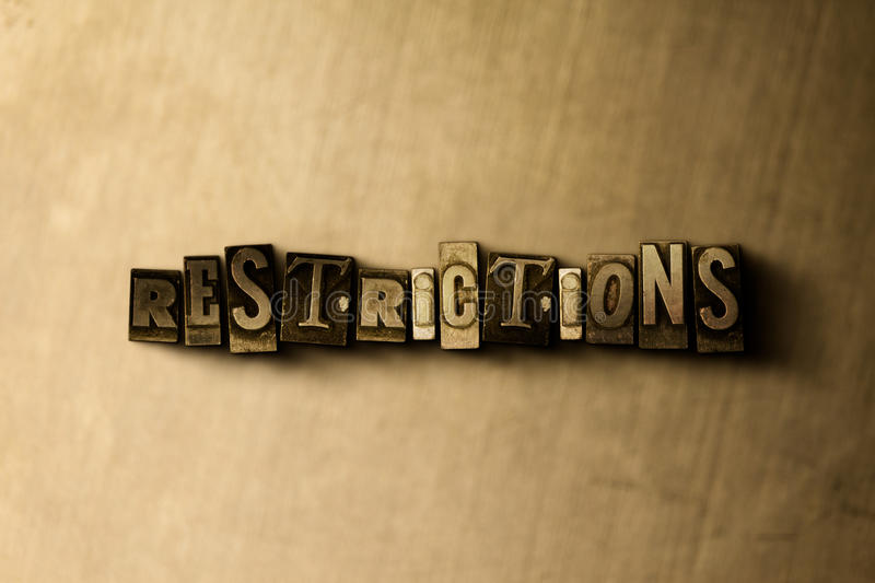 RESTRICTIONS - close-up of grungy vintage typeset word on metal backdrop. Royalty free stock illustration. Can be used for online banner ads and direct mail royalty free illustration