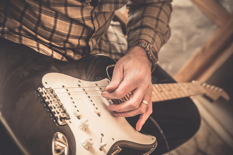 Restringing Guitar stock photo
