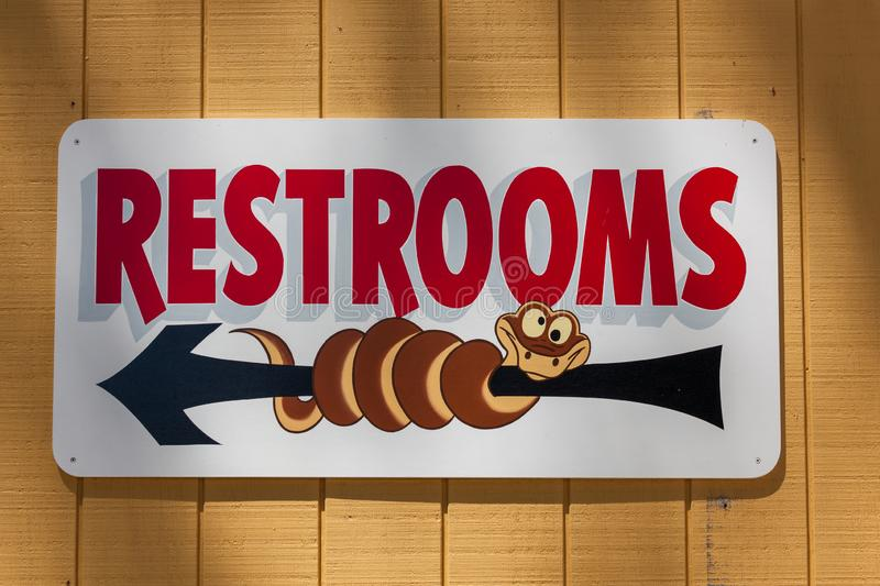 Restroom Sign with Cartoon Character stock photo