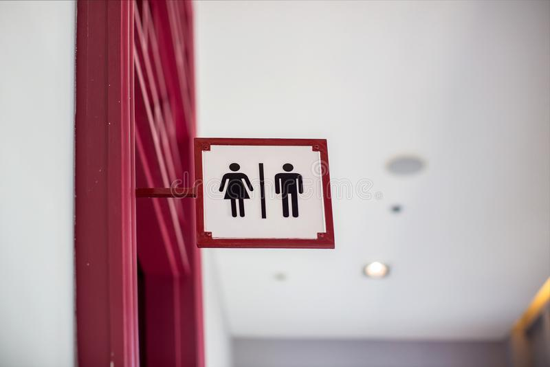 Restroom sign Hanging on the ceiling in the department store. Image for sign and symbol object stock photography