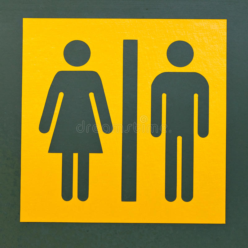 Restroom sign symbol for men and women. Signpost for men and women or male and female as often used to indicate restrooms with two silhouetted figures standing royalty free stock image