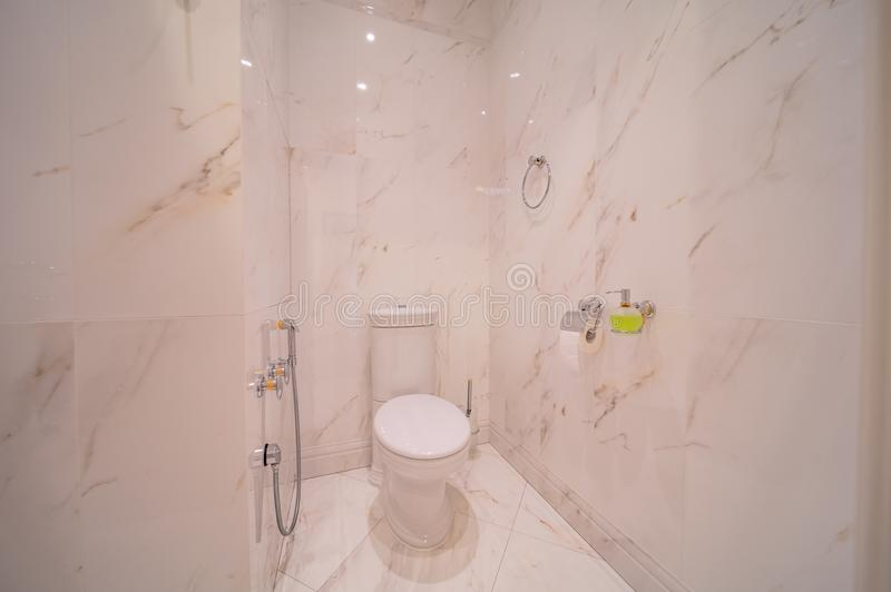 Restroom with toilet. Toilet bowl in the bathroom. Restroom with pink marble decoration royalty free stock images
