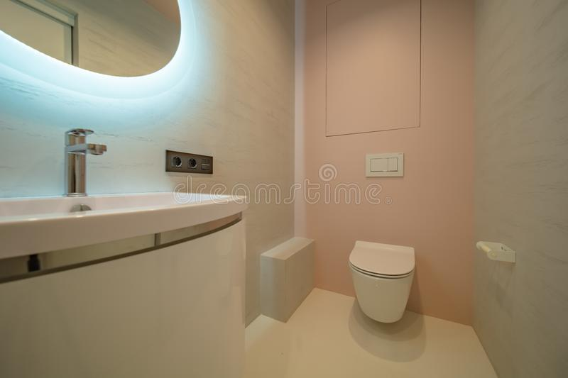 Restroom with toilet. Toilet bowl in the bathroom. Restroom with sink and mirror stock photo