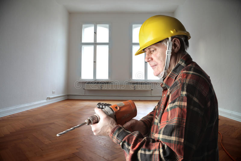 Restructuring. Senior worker restructuring house interior stock photo