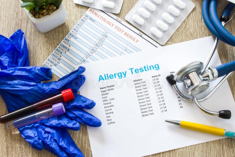 Result of allergy testing on working table in working environment of doctor of internal medicine, allergologist, general practice,. Pediatrician top view top stock image