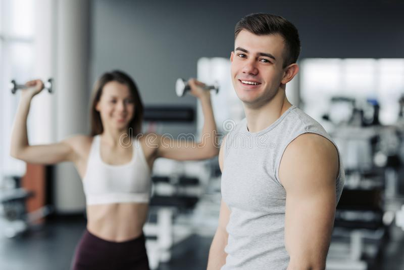 Result take effort. The athlete relaxing in the gym after strength exercises for different muscles, work out his body, push-up, royalty free stock photos