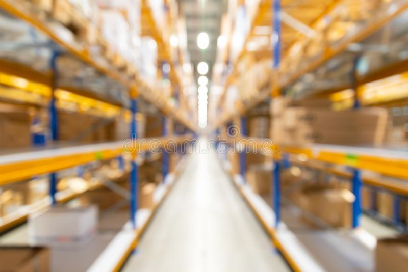 Resuma el almacén borroso en la planta, fondo para la industria imagen de archivo libre de regalías