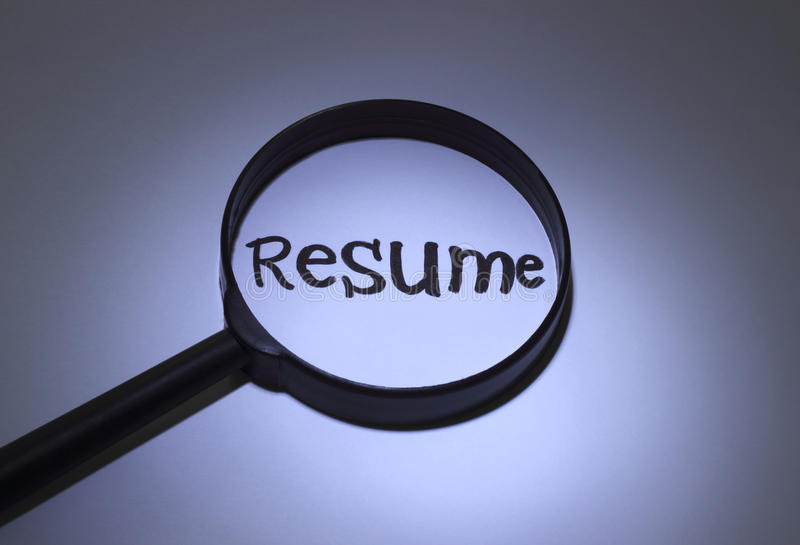 Resume. Inscription word magnified under a magnifying glass stock photo