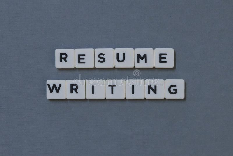 ' Resume Writing ' word made of square letter word on grey background royalty free stock photography
