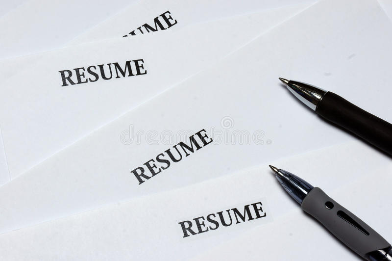 Resumes. A closeup picture of resumes and ball point pens royalty free stock image
