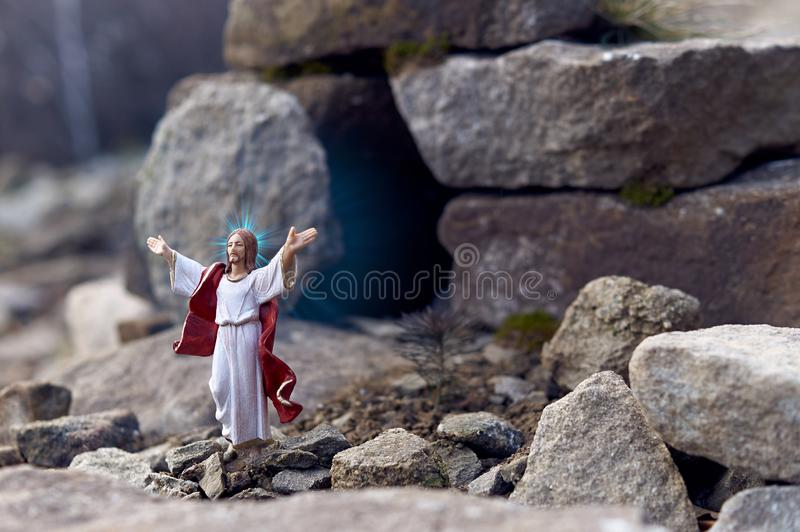 Resurrected Jesus Christ standing in front of the entrance to the grave - tomb. God bless the world royalty free stock images
