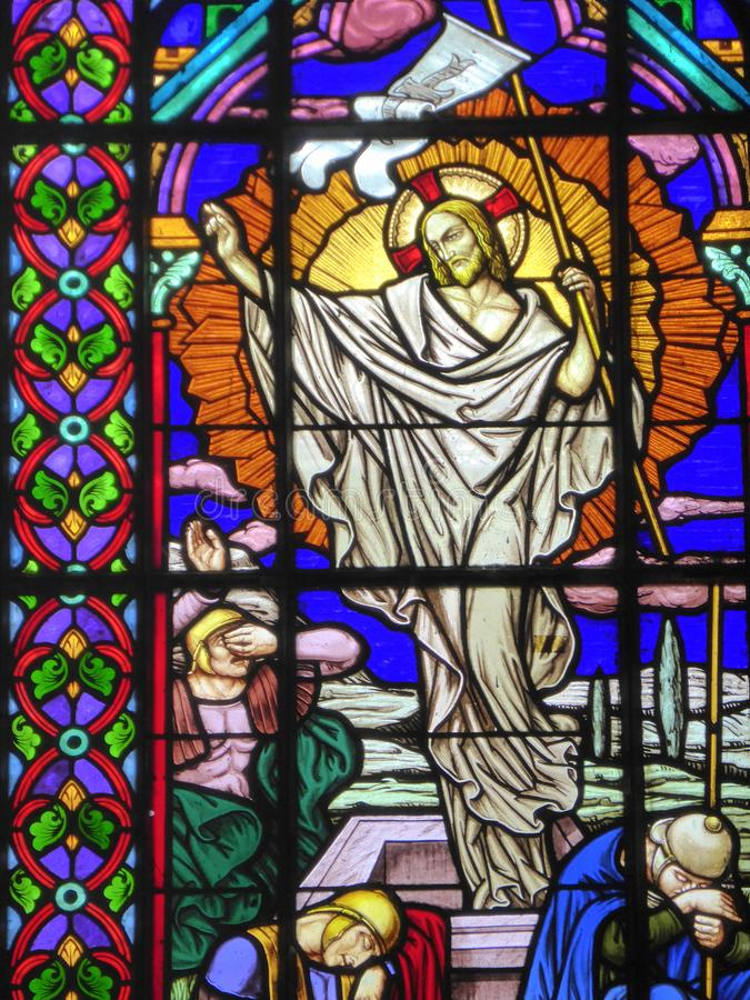 Resurrection of Christ on stained glass window. The resurrection of Jesus Christ on a church stained glass window royalty free stock photos