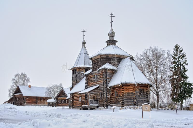 Resurrection Church and Peasant Houses Covered Snow. SUZDAL, VLADIMIR REGION, RUSSIA - Resurrection Church and Peasant Houses Covered Snow the Museum of Wooden stock image