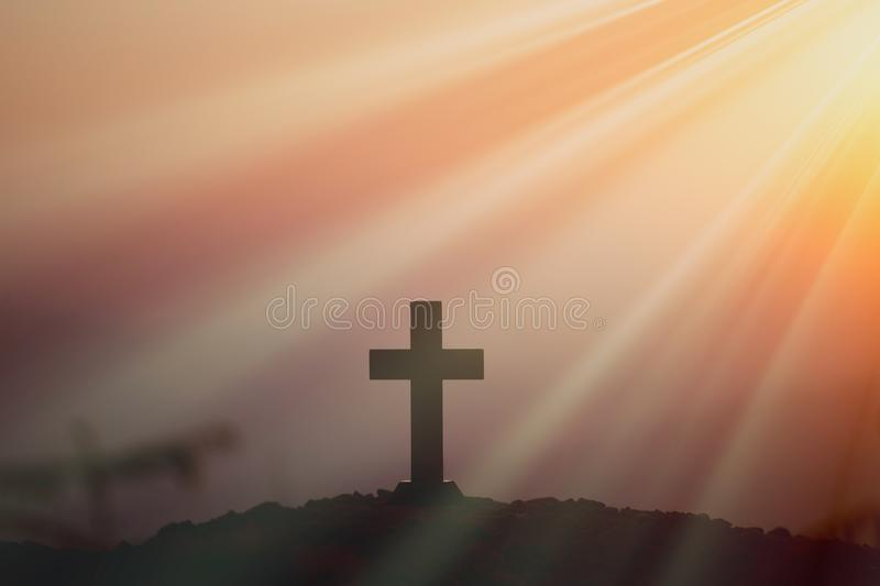 Resurrection concept:Crucifixion Of Jesus Christ Cross At Sunset. Faith of christian concept: Spiritual prayer hands over sun shine with blurred beautiful sunset stock photography