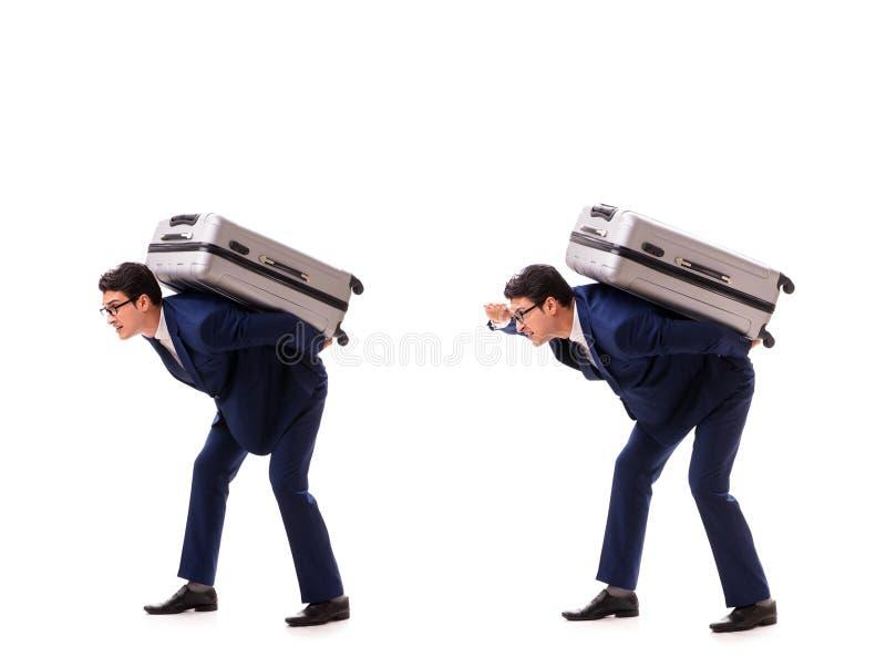 Resväskan för laddningar för affärsmanfasadbeklädnadöverskott den tunga tack vare royaltyfri foto
