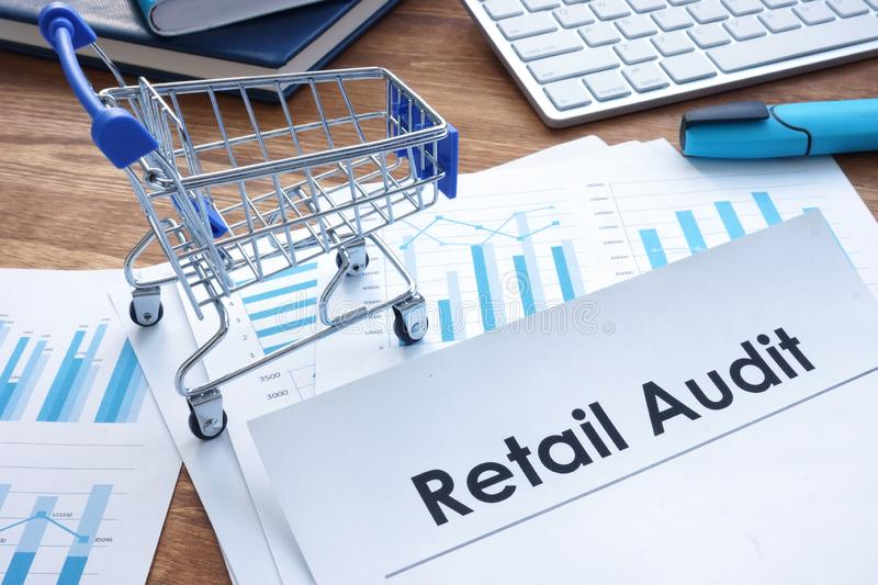 Retail audit report and business papers. On the table royalty free stock image