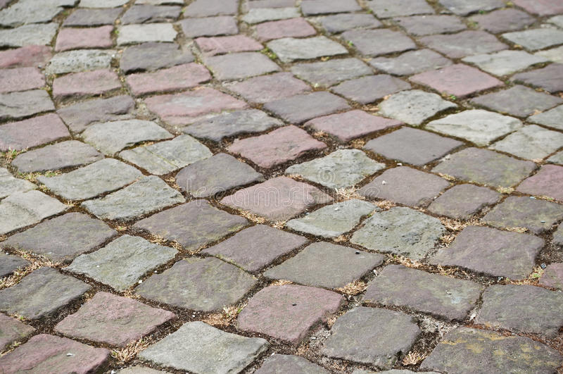 Retail of cobbles in the street. Retail of cobbles with design in the street royalty free stock photo