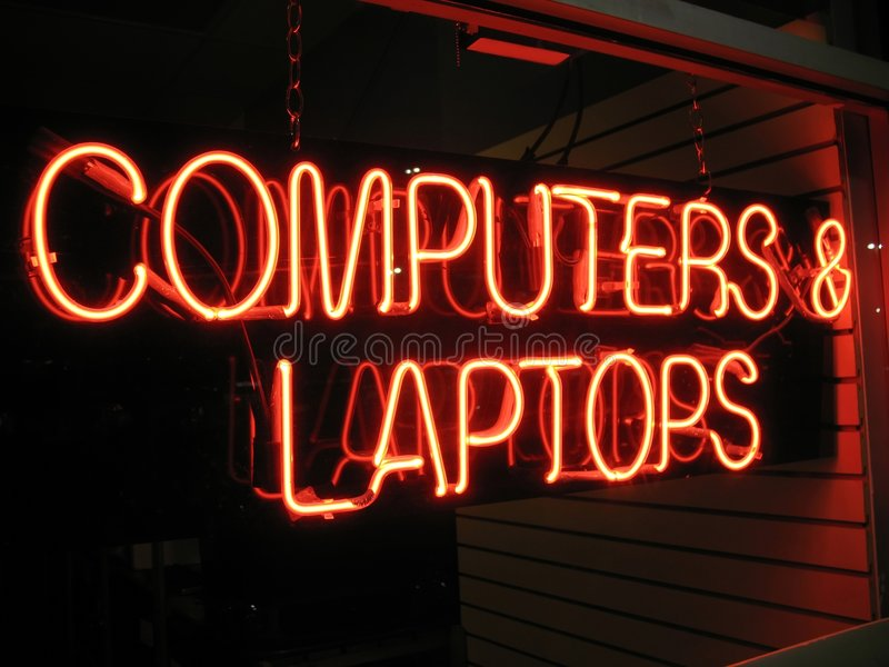 Retail Computer Store. Photo of retail computer store sign at night royalty free stock photos