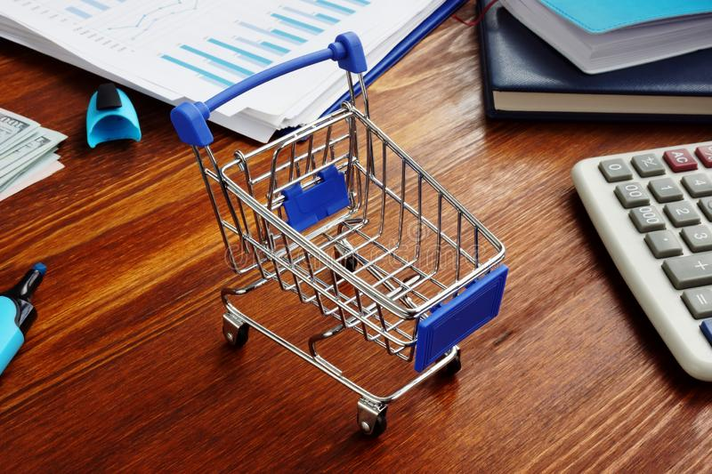 Retail marketing. Shopping cart on a desk stock photo