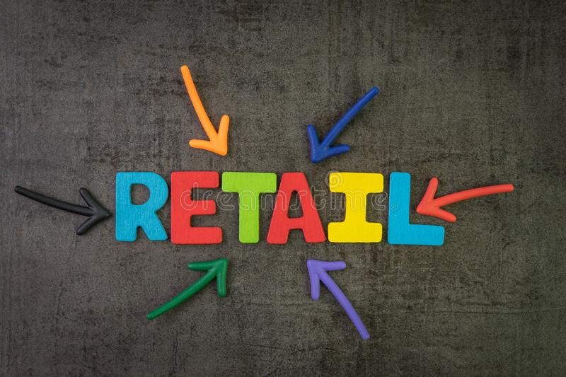 Retail, the process of selling consumer goods or services to customers concept, multi color arrows pointing to the word Retail at. The center of black cement royalty free stock image