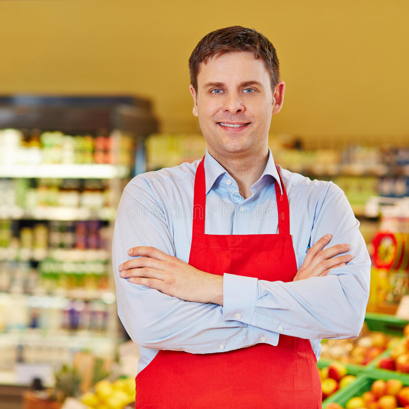 Retail salesman in a supermarket. Portrait of happy retail salesman in a supermarket stock images