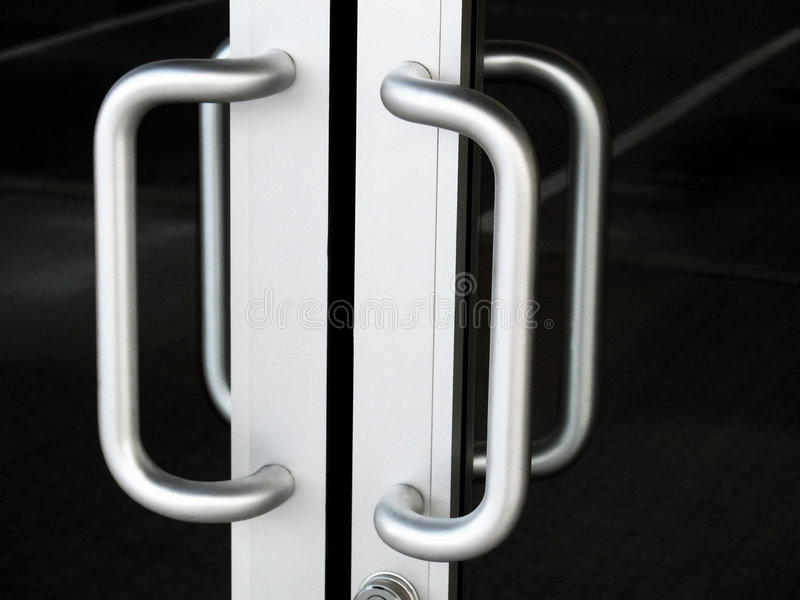 Retail Shop Entrance. Close up of double door handles on retail building royalty free stock image