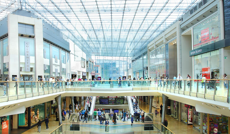 Busy retail shopping mall. Busy modern retail shopping mall / centre with people shoppers shopping. Birmingham Bullring, UK