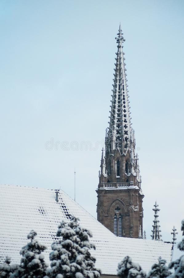 St Etienne temple bell tower covered by the snow in Mulhouse - France. Retail of st Etienne temple bell tower covered by the snow in Mulhouse - France stock image
