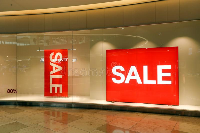 Retail store window displays sale and discount signage. Retail store sale and discount signage displayed in a window royalty free stock photo