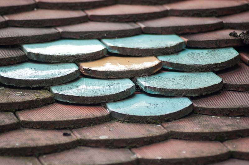 Traditional terra cotta roof tiles texture with colorful ceramic tiles. Retail of traditional terra cotta roof tiles texture with colorful ceramic tiles stock photography