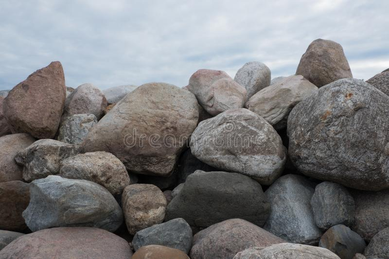 Retaining wall made of stones, boulders. stock images