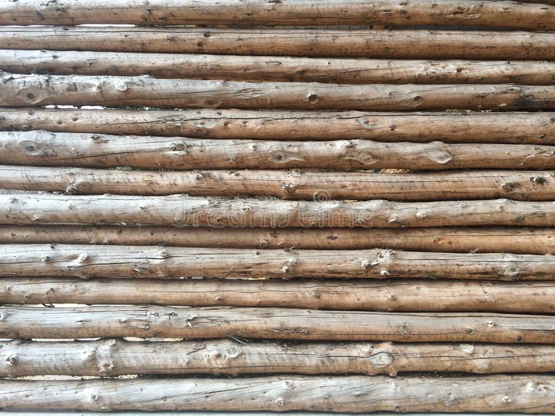 Retaining Wall of Stacked Logs. This retaining wall of stacked peeled logs is used to hold in wood chips stock image