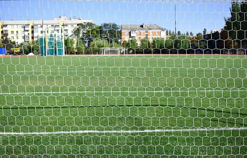 Rete di calcio contro lo sfondo di un campo di football americano immagini stock libere da diritti