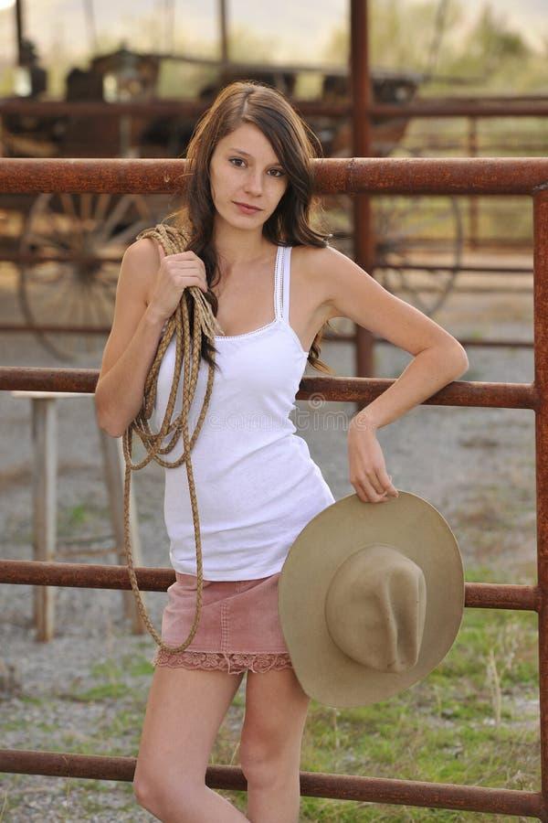 Rete fissa rampicante del giovane Cowgirl fotografia stock