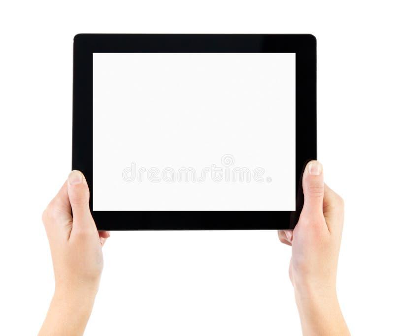 Retenir le PC électronique de tablette dans des mains photo stock