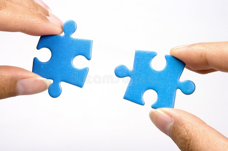 Retenir le puzzle denteux photographie stock libre de droits
