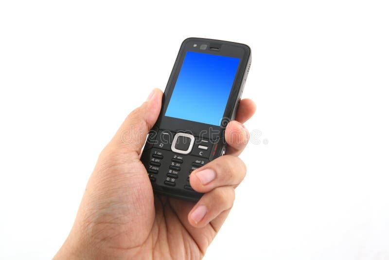 Retenir un téléphone portable photo libre de droits