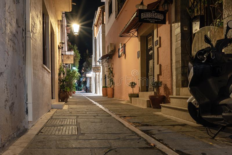 Night narrow street of Rethymno town, Crete island, Greece. RETHYMNO, GREECE - AUGUST 2018: Night narrow street of Rethymno town, Crete island, Greece stock photos
