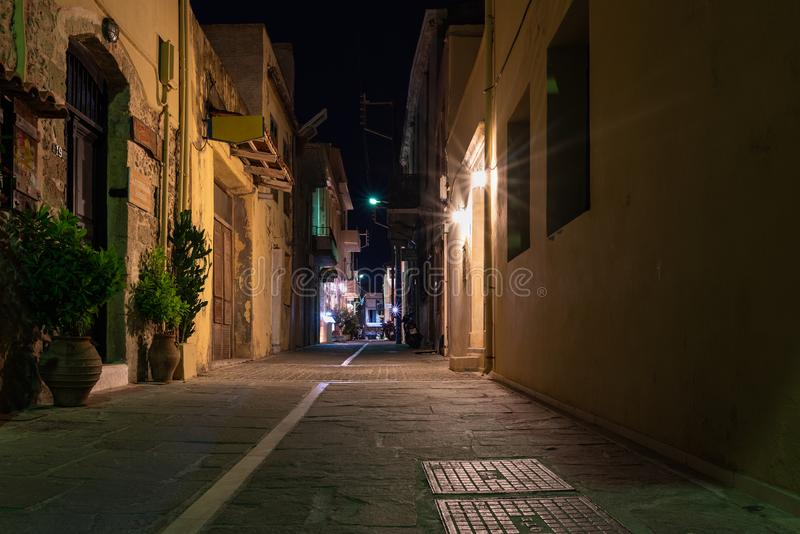 Night narrow street of Rethymno town, Crete island, Greece. RETHYMNO, GREECE - AUGUST 2018: Night narrow street of Rethymno town, Crete island, Greece royalty free stock photo